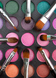 Makeup brushes and shadows Royalty Free Stock Photography