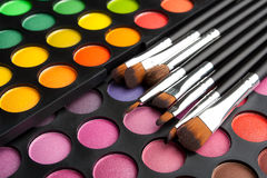 Makeup brushes and shadows Royalty Free Stock Images