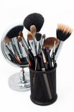 Makeup brushes and mirror. Mirror and makeup brushes on a white background Stock Photos