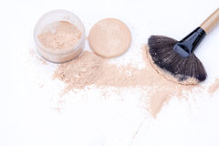 Makeup brushes and natural tone loose powder Royalty Free Stock Photos