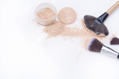 Makeup brushes and natural tone loose powder Royalty Free Stock Images