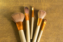 Makeup brushes over a wood background Royalty Free Stock Photography