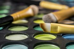 Makeup brushes on palette stock images