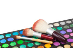 Makeup brushes and set of colorful eye shadows Royalty Free Stock Image