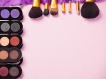 Makeup Brushes. On pink background Royalty Free Stock Images