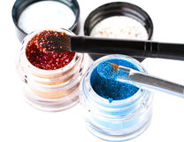 Makeup brushes and powder. Over white Royalty Free Stock Images