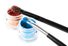 Makeup brushes and powder. Over white Royalty Free Stock Photo