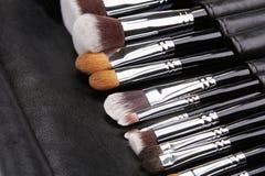 Makeup brushes set on black leather background.  Royalty Free Stock Photos