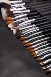 Makeup brushes set on black leather background Royalty Free Stock Photo