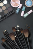 Makeup brushes set with eyeshadows and nail paints Royalty Free Stock Photos