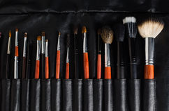 Makeup brushes. Set of makeup brushes in leaser case stock images