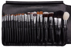 Makeup brushes set in leather case. Isolated. White background Royalty Free Stock Photo