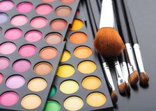Makeup brushes and shadows Stock Image