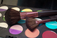 Makeup brushes on shadows Royalty Free Stock Photos