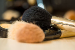 Makeup brushes on tabel. Makeup brushes on background of tabel. Make-up background Stock Photos