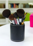 Makeup brushes on table Royalty Free Stock Images