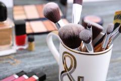 Makeup brushes on table, closeup royalty free stock photos