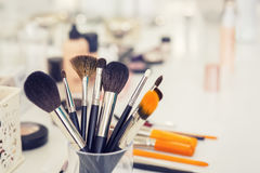Makeup brushes on table royalty free stock photo