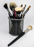 Makeup brushes on a white background. Makeup brushes in a glass on a white background Royalty Free Stock Photography