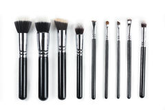 Makeup brushes on white background. Makeup brushes lying on a white background Royalty Free Stock Images