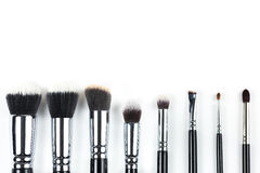 Makeup brushes on white background. Makeup brushes lying on a white background Stock Photo