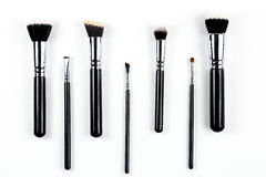 Makeup brushes on white background. Makeup brushes lying on a white background Stock Photos