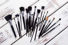 Makeup brushes  on a white wooden board. Stock Photos