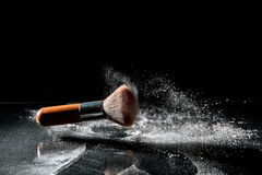 Makeup brusk and powder. On black background with copy space royalty free stock images