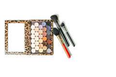 Makeup collection brushes and shadows isolated white background. Close-up Royalty Free Stock Photos
