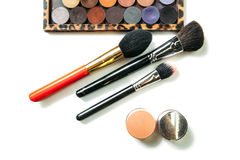 Makeup collection brushes and shadows isolated white background. Close-up Stock Images