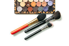 Makeup collection brushes and shadows isolated white background. Close-up Royalty Free Stock Image