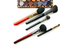 Makeup collection brushes and shadows isolated white background. Close-up Stock Photography