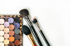 Makeup collection brushes and shadows isolated white background. Close-up Stock Photo