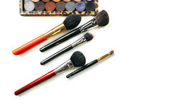 Makeup collection brushes and shadows isolated white background. Close-up Stock Image
