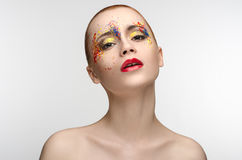 Makeup colored paint on the eyes Beauty Girl Stock Photo