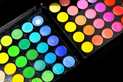 Makeup colours. Makeup kit by multiple colours  copy space Royalty Free Stock Photos