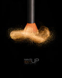 Makeup concept. Cosmetics brush with glowing face powder Royalty Free Stock Photography