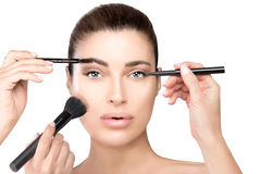 Makeup concept. Gorgeous woman with makeup tools Royalty Free Stock Image