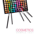 Makeup and cosmetic brushes. Set of different colored makeup with cosmetic brushes on a white background with copy space Royalty Free Stock Image