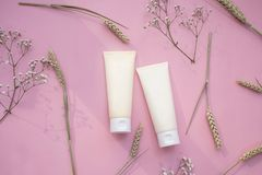 Makeup cosmetic tube 2 product. beauty fashion pink flat lay royalty free stock photo