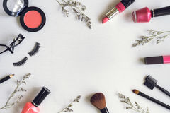 Makeup cosmetics and brushes. On white wooden background Stock Photo