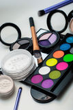 Makeup cosmetics. Colorful Eyeshadows, brushes, powder and mirror Royalty Free Stock Photo