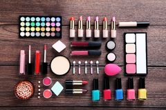 Makeup cosmetics. Different makeup cosmetics on brown wooden table Stock Photos