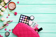 Makeup cosmetics. Different makeup cosmetics on mint wooden table Stock Photos