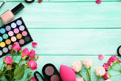 Makeup cosmetics. Different makeup cosmetics on mint wooden table Royalty Free Stock Photos