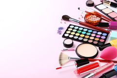 Makeup cosmetics. Different makeup cosmetics on a pink background Stock Photography