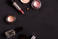 Makeup cosmetics essentials frame black background, copy space Stock Photography