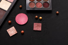 Makeup cosmetics essentials frame black background, copy space Royalty Free Stock Images