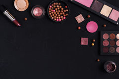 Makeup cosmetics essentials frame black background, copy space Stock Photo