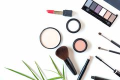 Makeup cosmetics tools background and beauty cosmetics, products and facial cosmetics package lipstick, eye shadow on the white ba royalty free stock photos